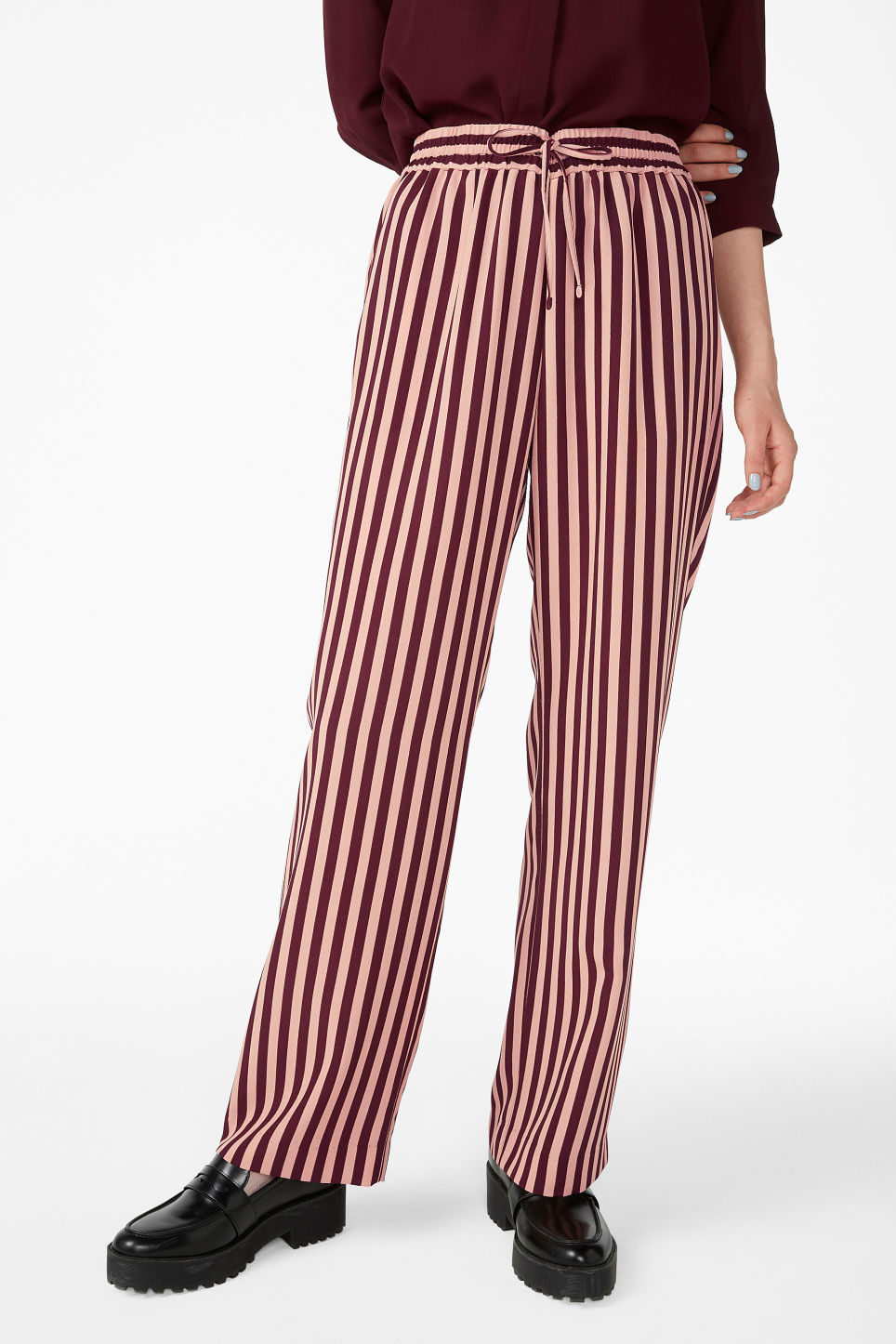 Model side image of Monki dressy trousers in pink