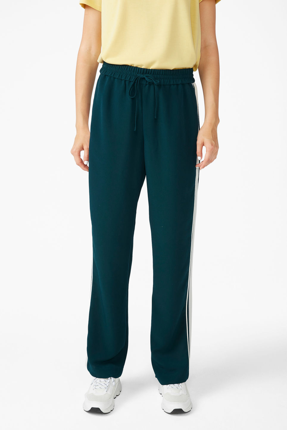 Model side image of Monki dressy trousers in green