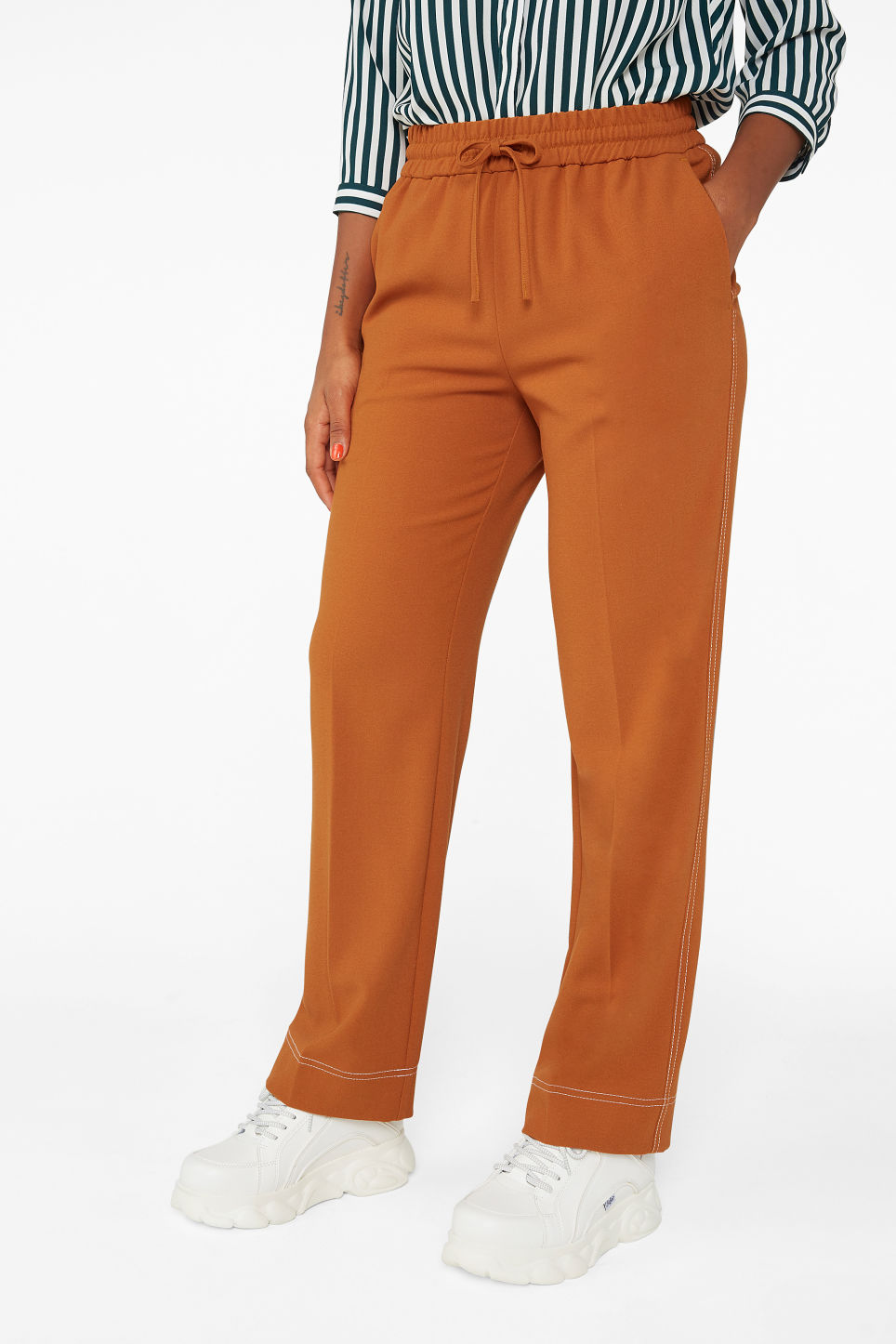 Model side image of Monki dressy trousers in orange