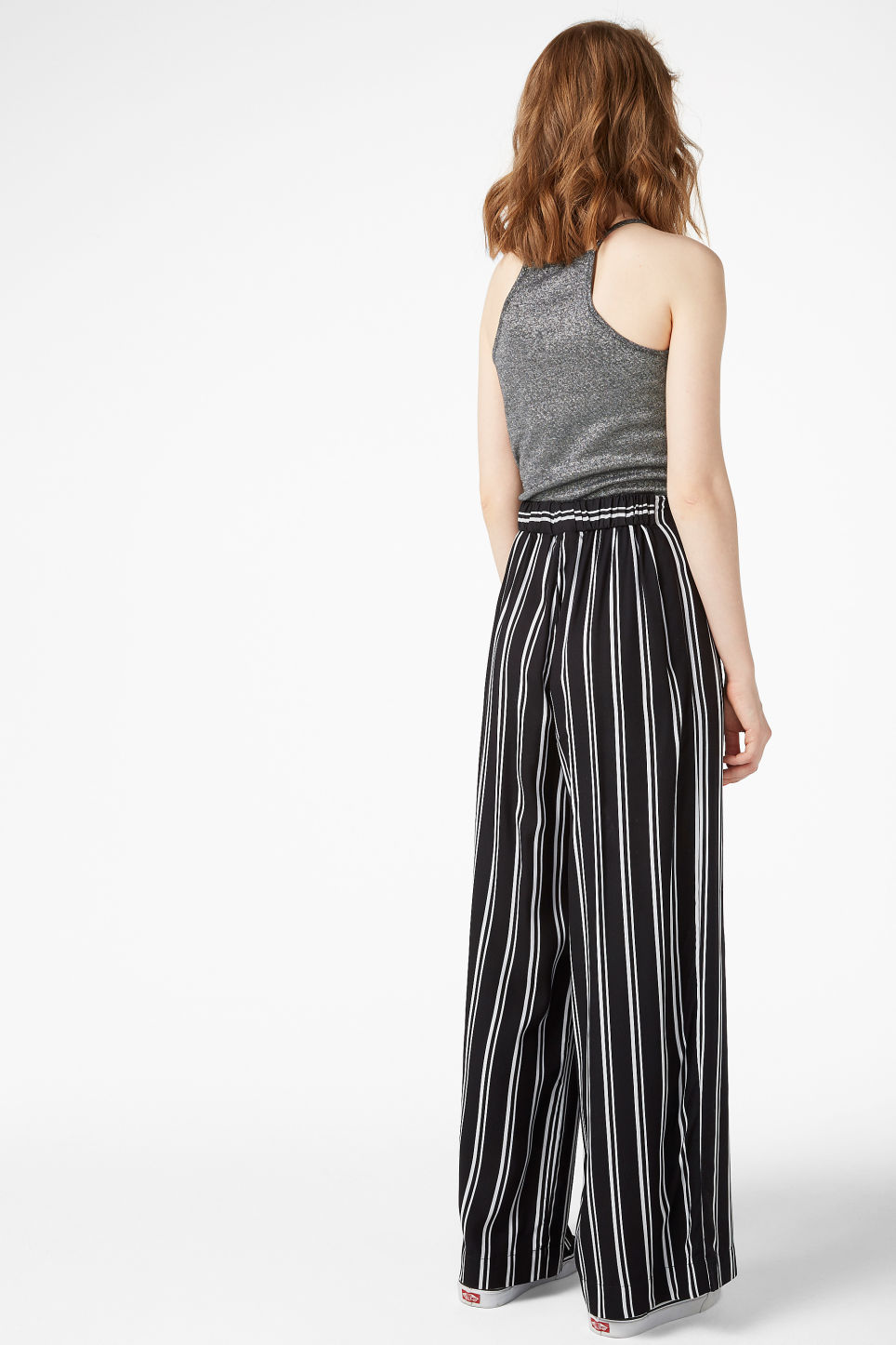 Model back image of Monki flowy trousers in black