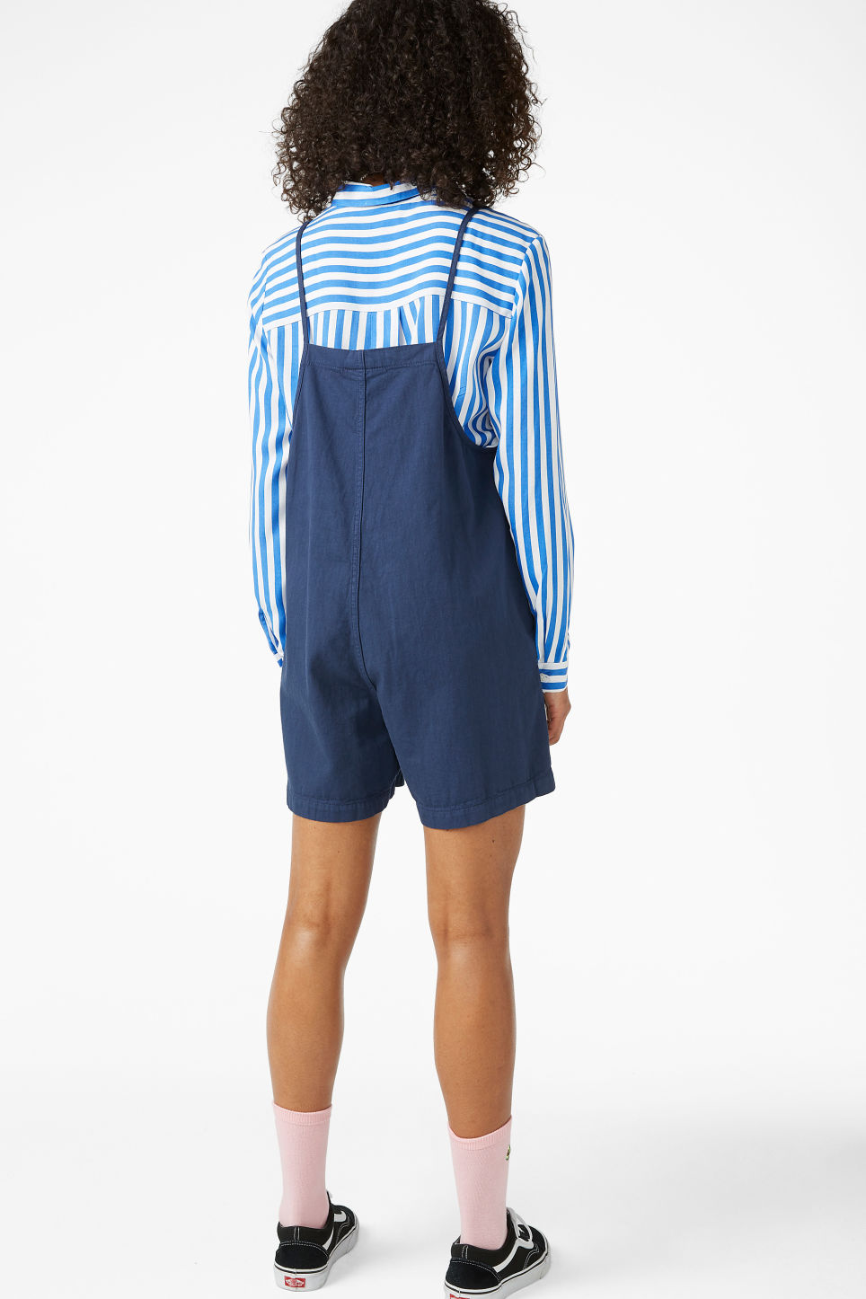 Model back image of Monki denim playsuit in blue