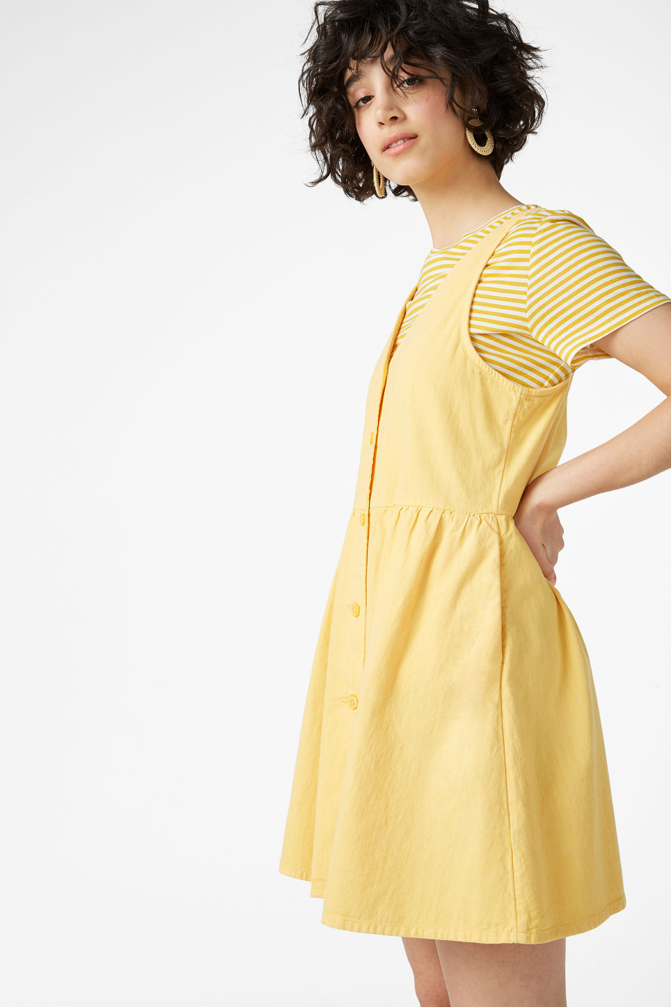 Model front image of Monki denim dress in yellow