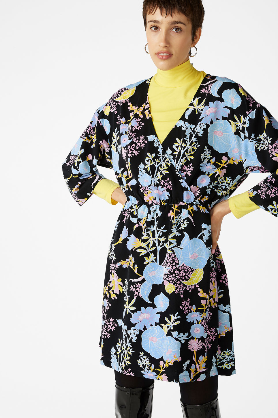 Model side image of Monki printed wrap dress in black