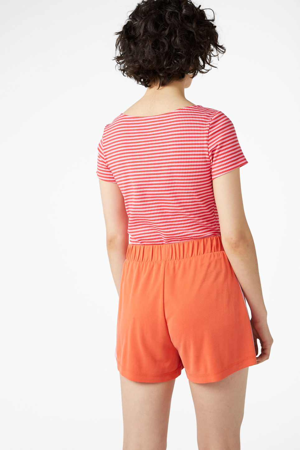 Model back image of Monki super-soft sporty shorts in orange