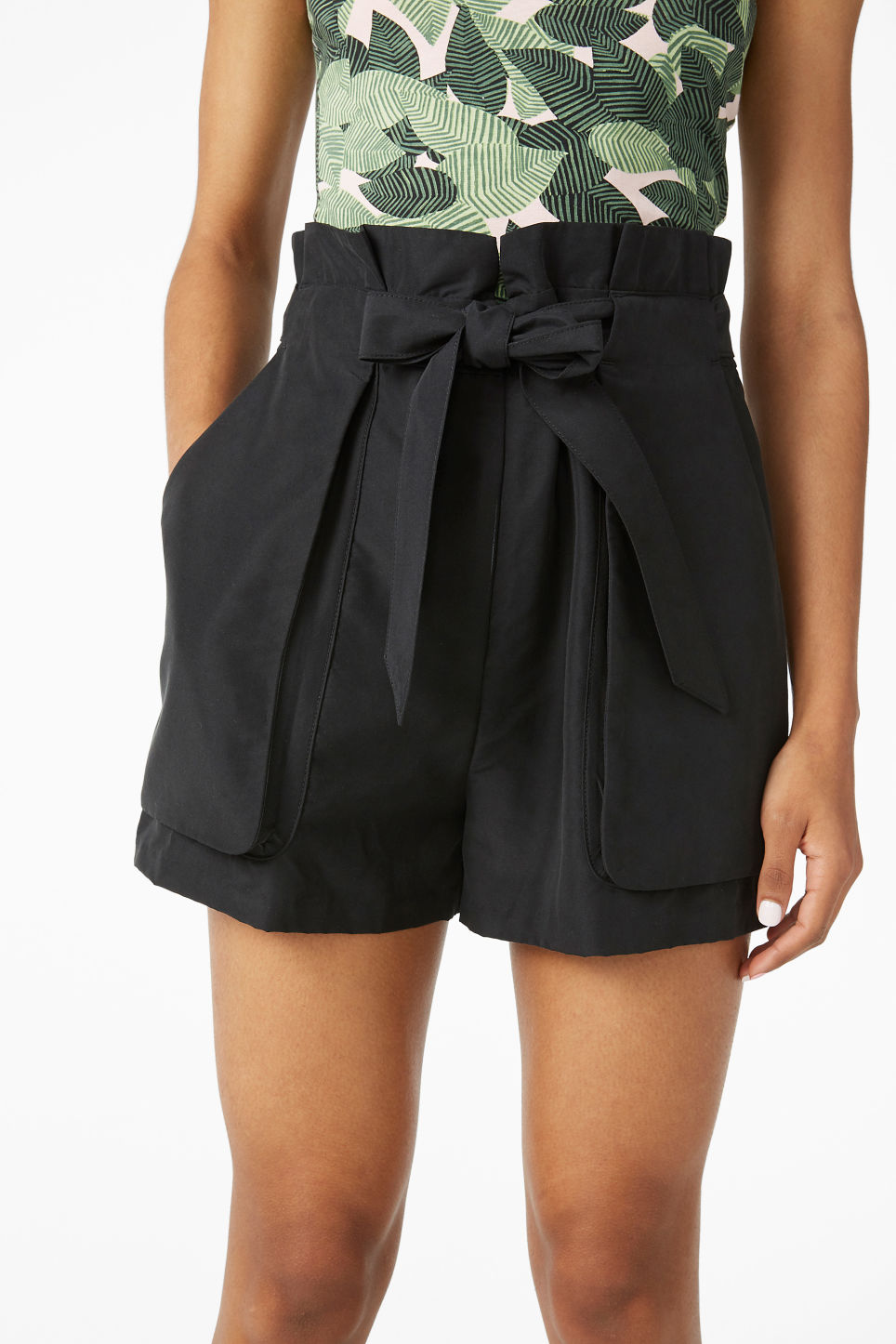 Model side image of Monki flowy shorts in black