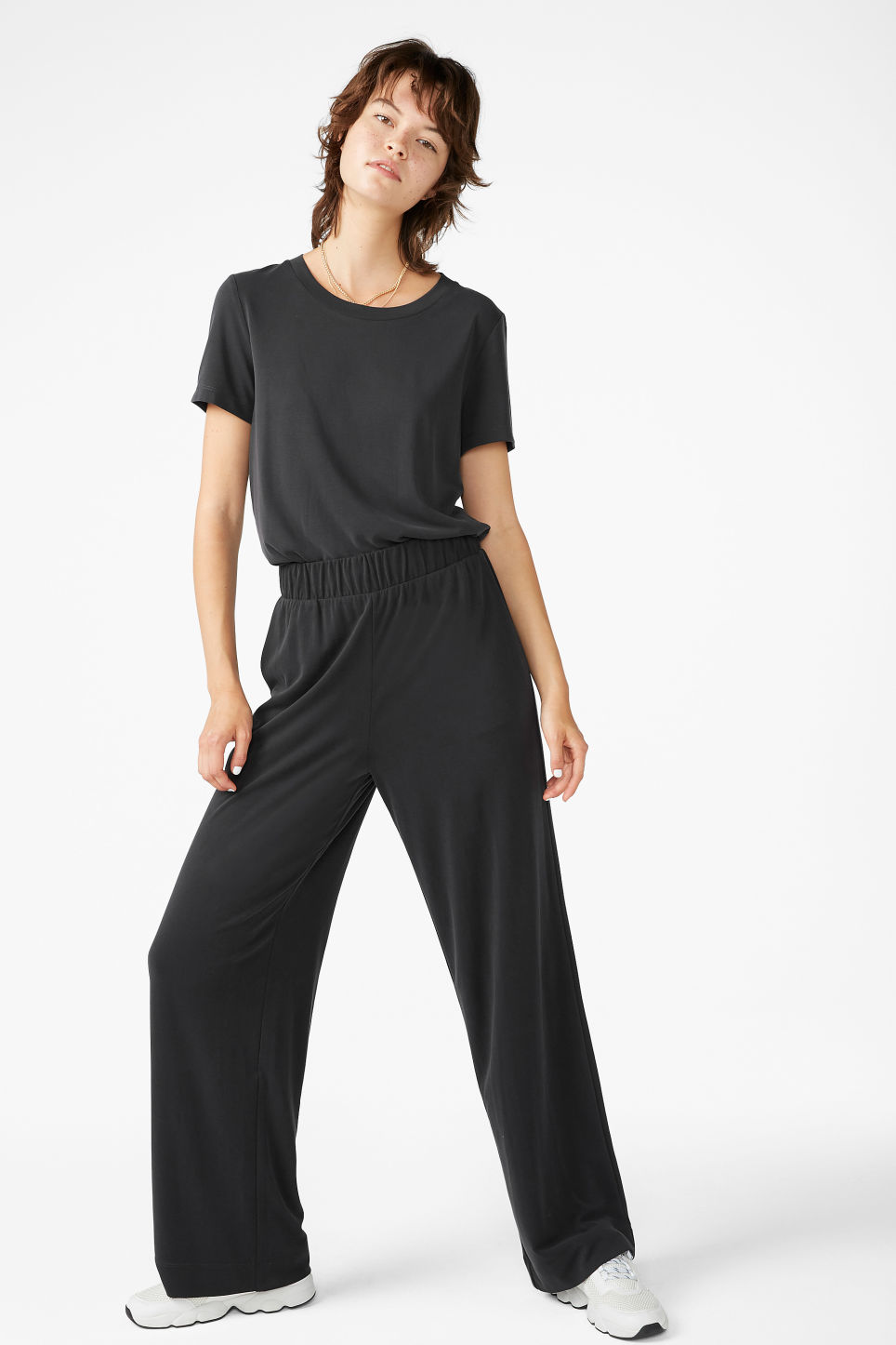 Model front image of Monki super-soft flowy trousers in black