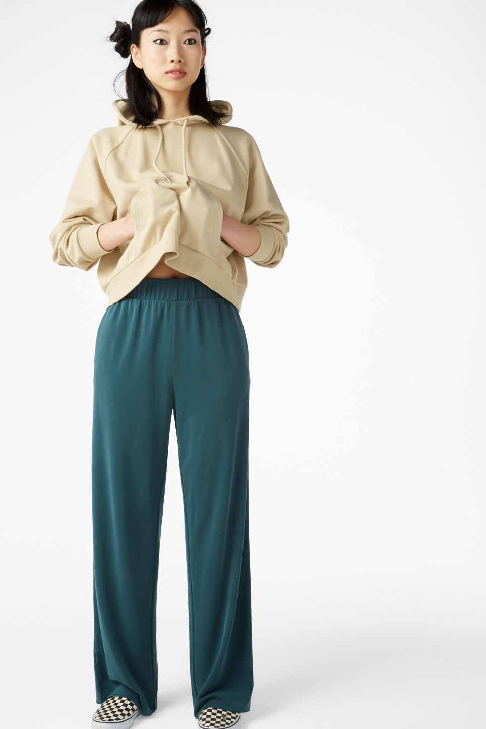 Model front image of Monki super-soft flowy trousers in green