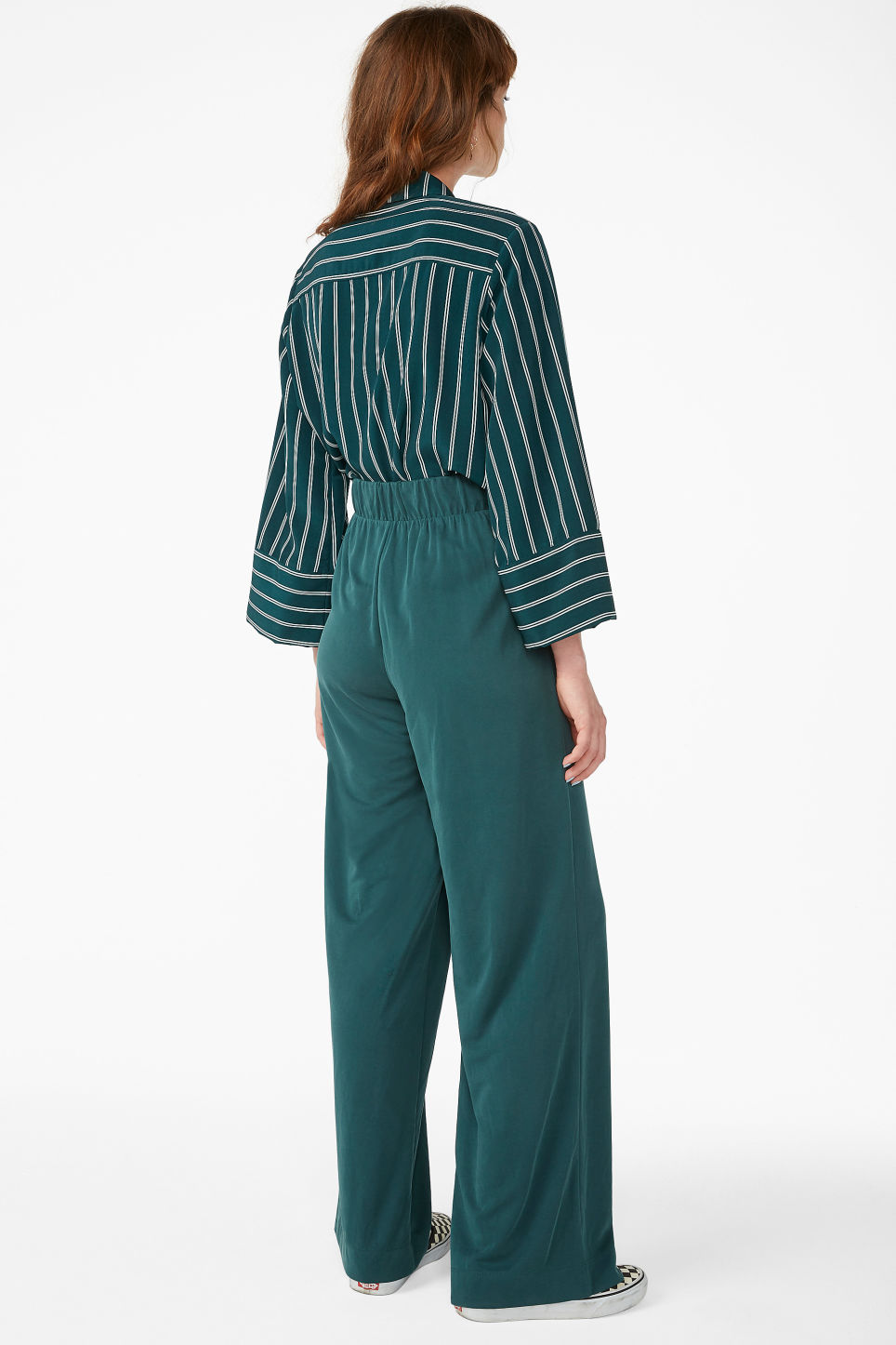 Model back image of Monki super-soft flowy trousers in green