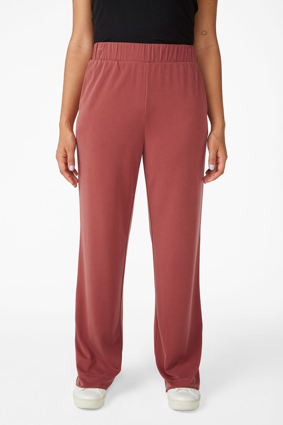 Model side image of Monki super-soft flowy trousers in red