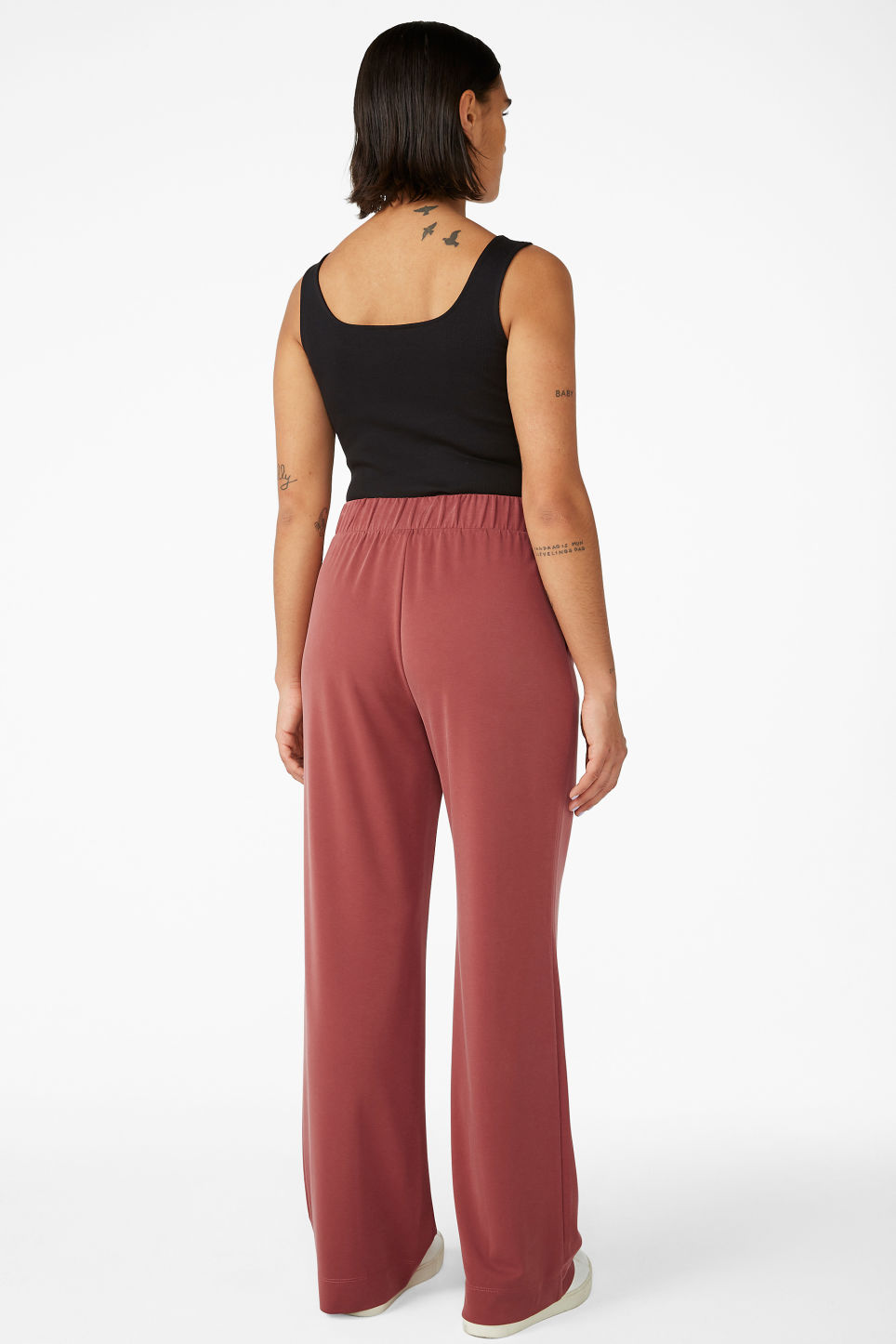 Model back image of Monki super-soft flowy trousers in red