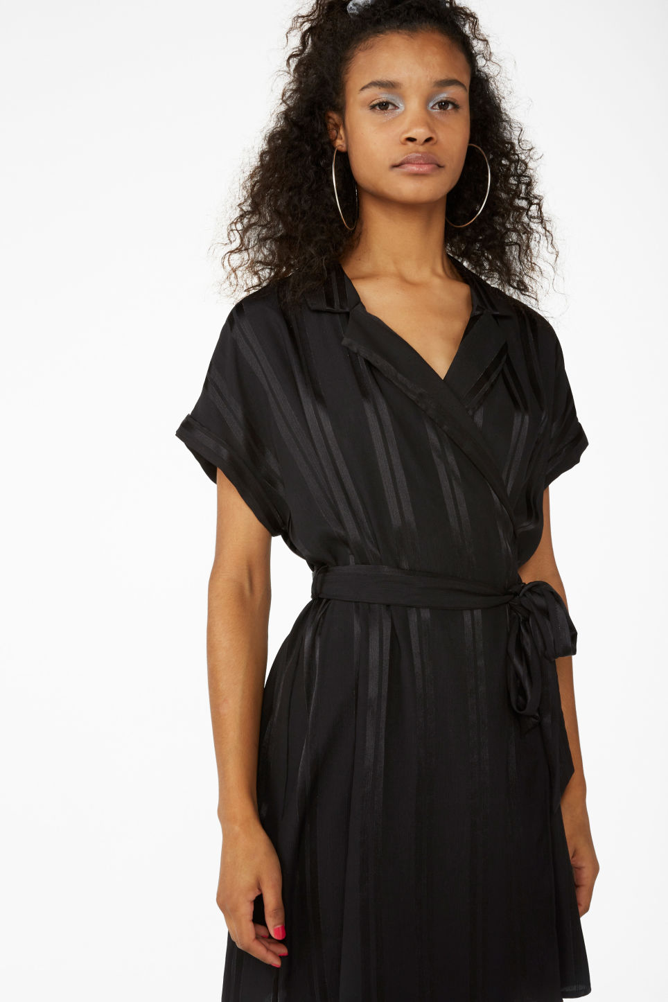 Model front image of Monki short-sleeved wrap dress in black