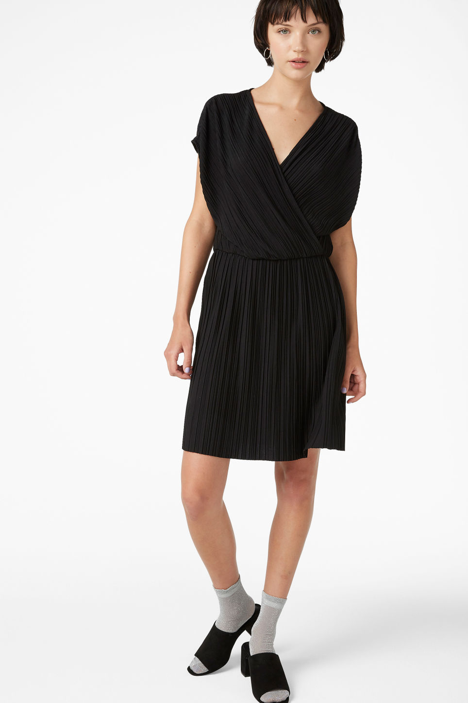 Model side image of Monki pleated wrap dress in black