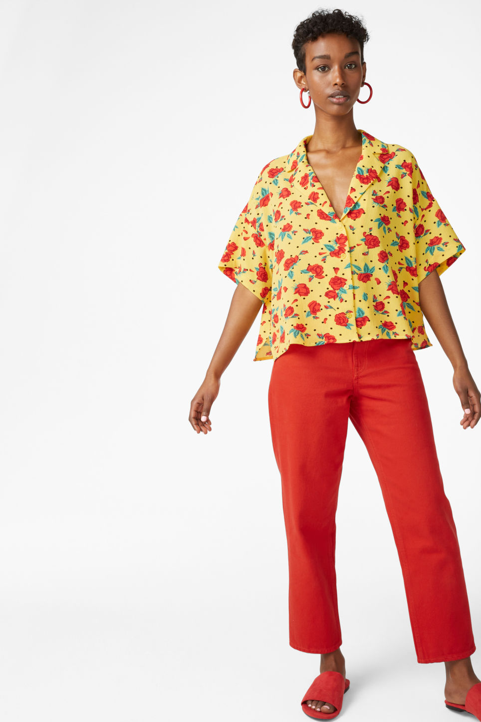 Model side image of Monki short-sleeved blouse in yellow