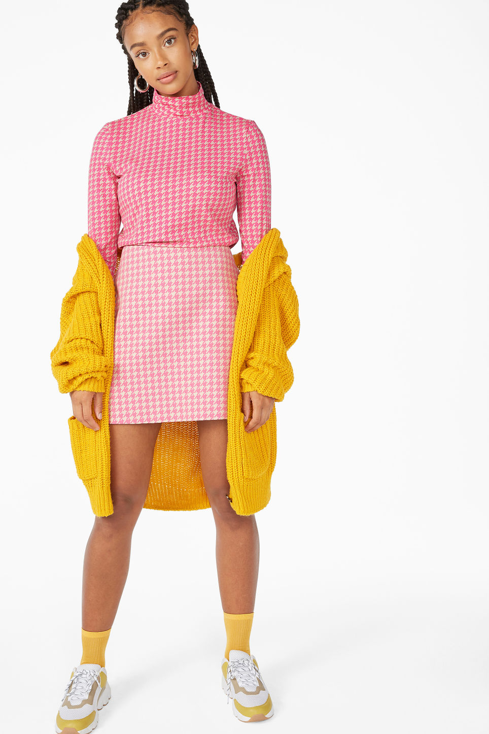 Model side image of Monki long-sleeved turtleneck in pink