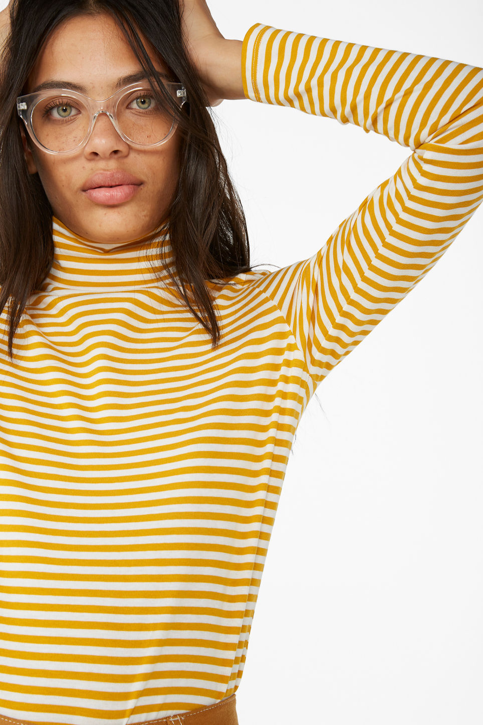Model front image of Monki stretchy turtleneck top in yellow