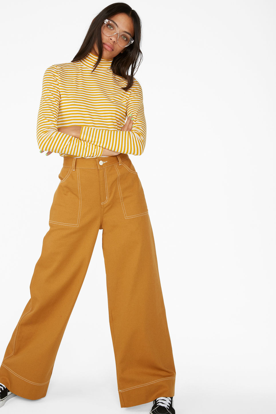 Model side image of Monki stretchy turtleneck top in yellow