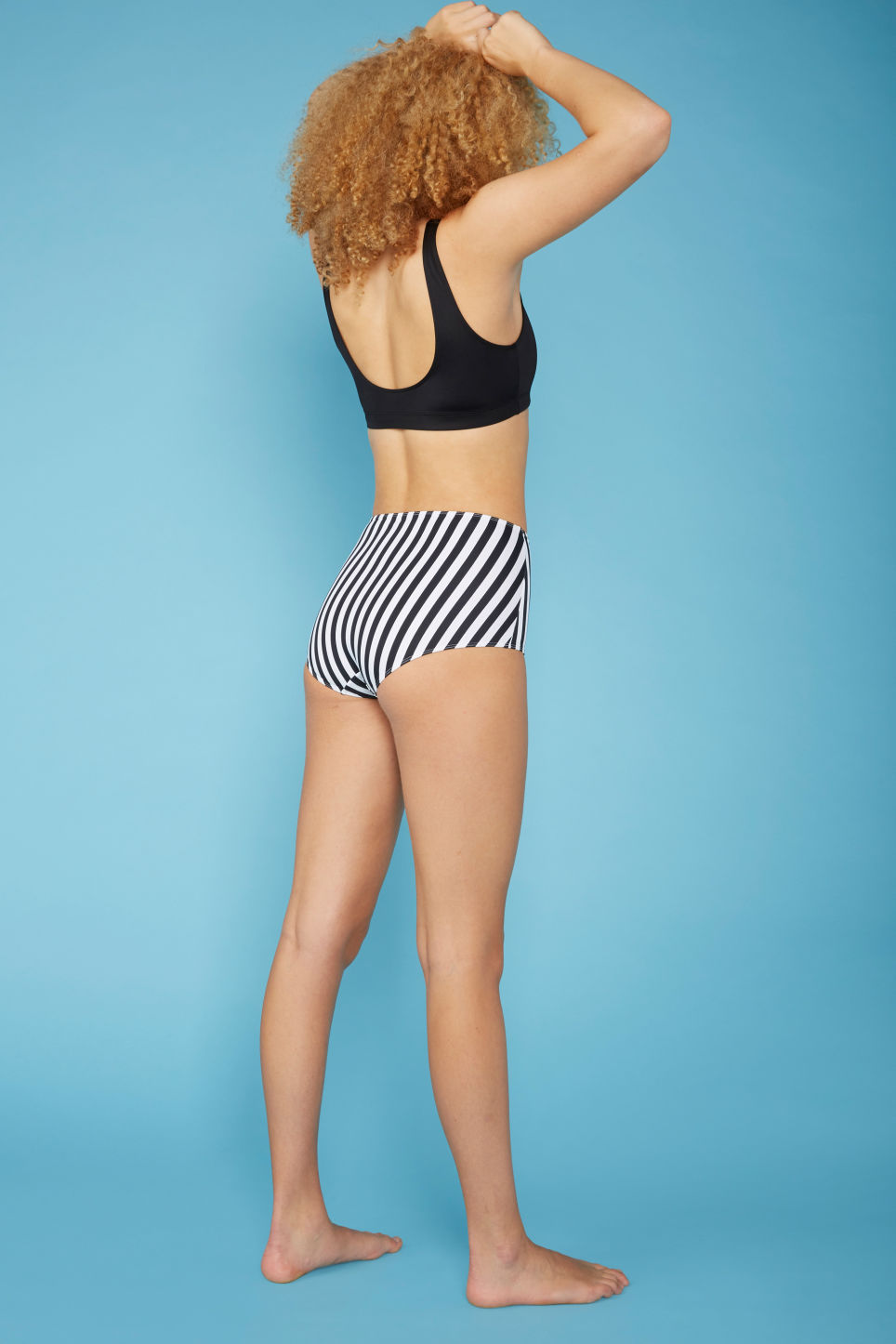 Model back image of Monki sporty bikini top in black
