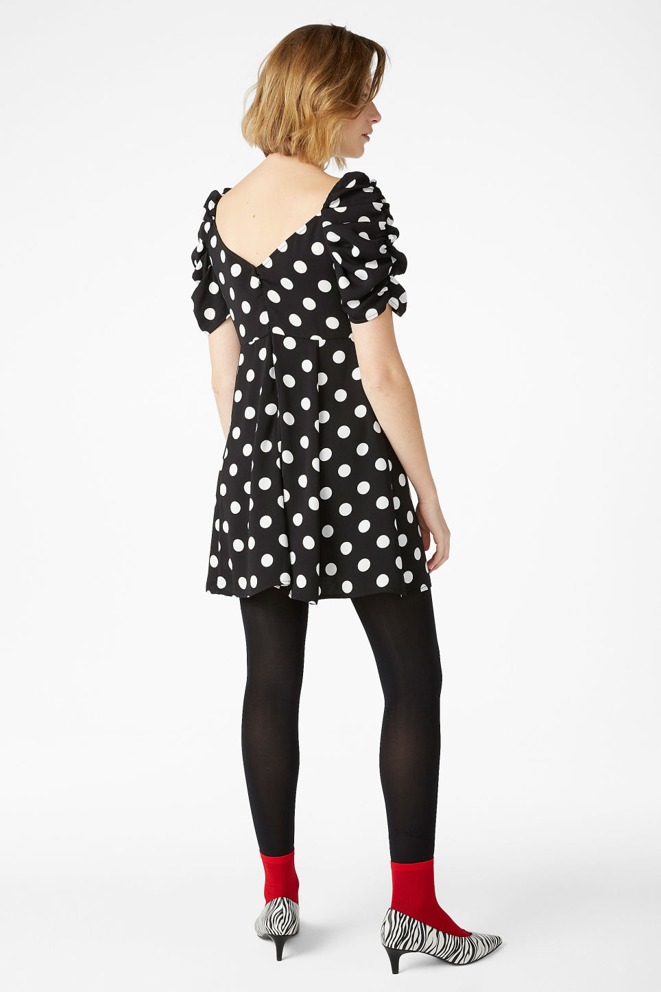 Model back image of Monki polka dot dress in black