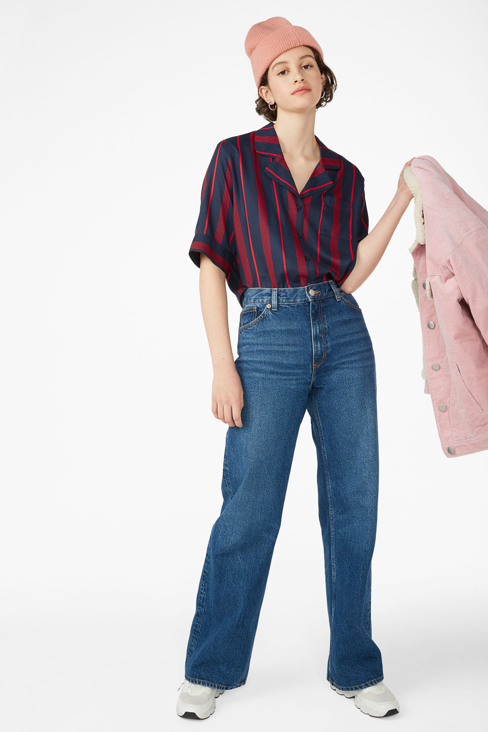 Model side image of Monki button-up blouse in blue