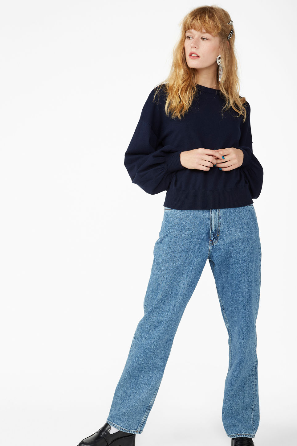 Model side image of Monki balloon sleeved sweater in blue