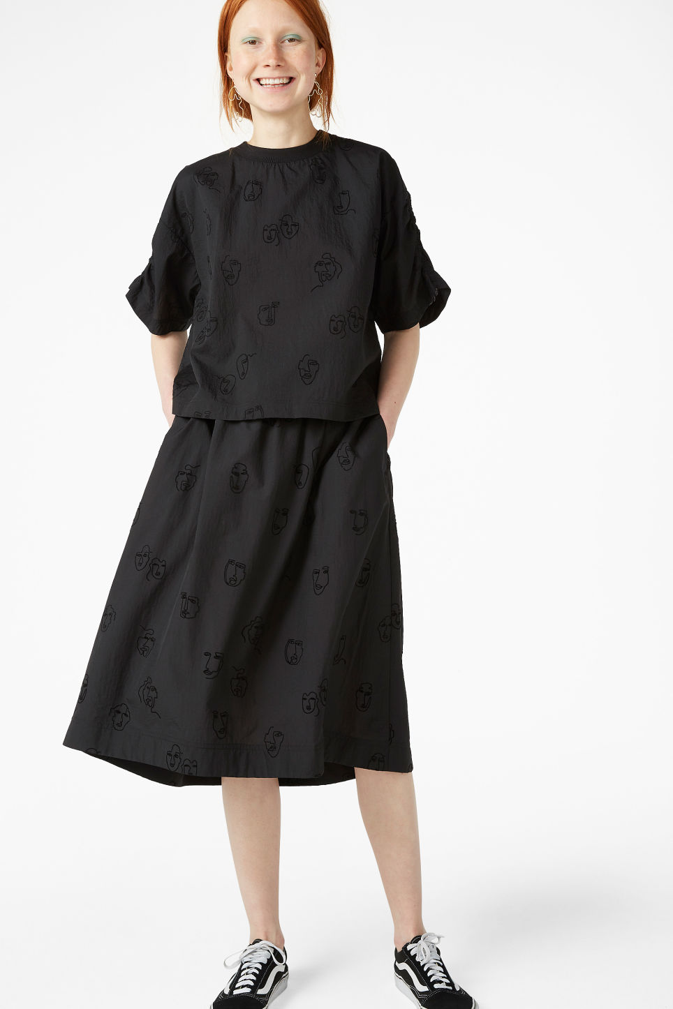 Model front image of Monki ruffle sleeve blouse in black