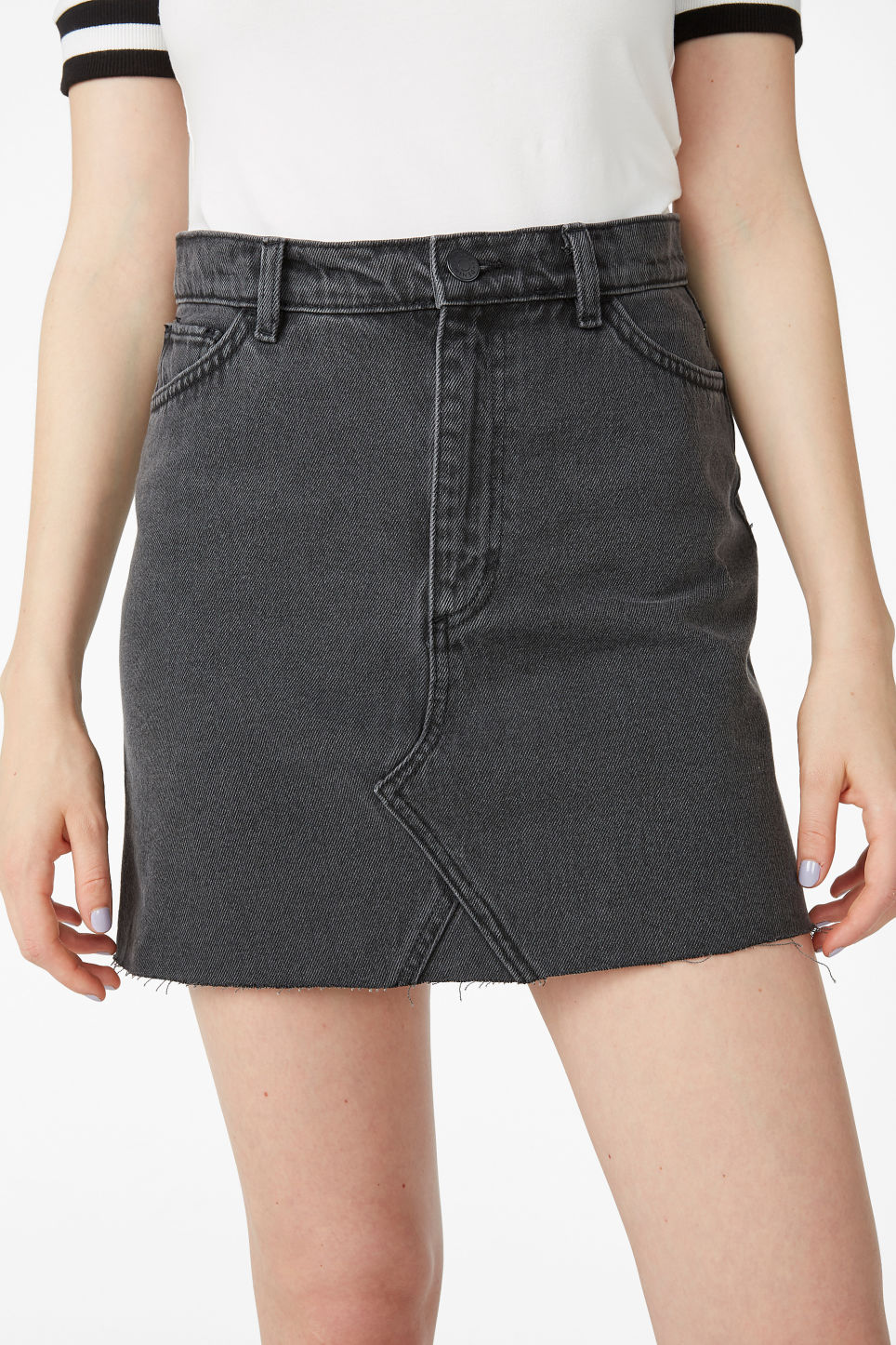 Model side image of Monki denim mini skirt  in black