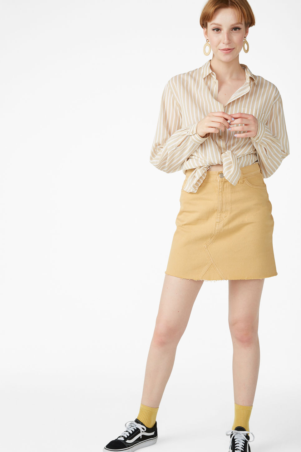Model front image of Monki denim mini skirt  in yellow