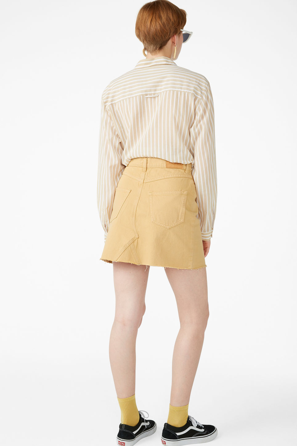 Model back image of Monki denim mini skirt  in yellow