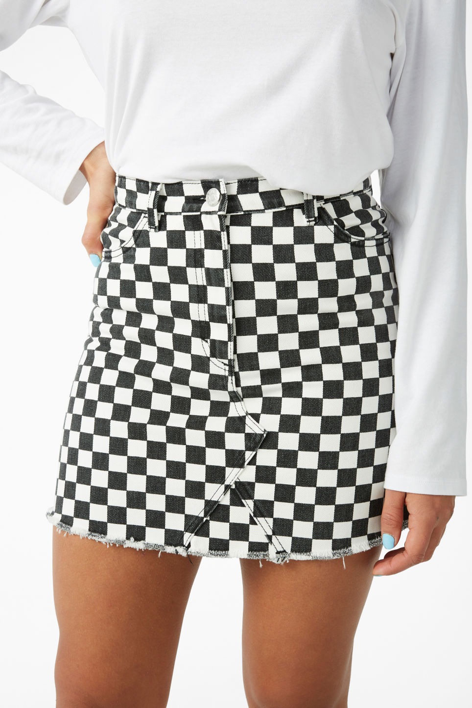 Model side image of Monki denim mini skirt  in white