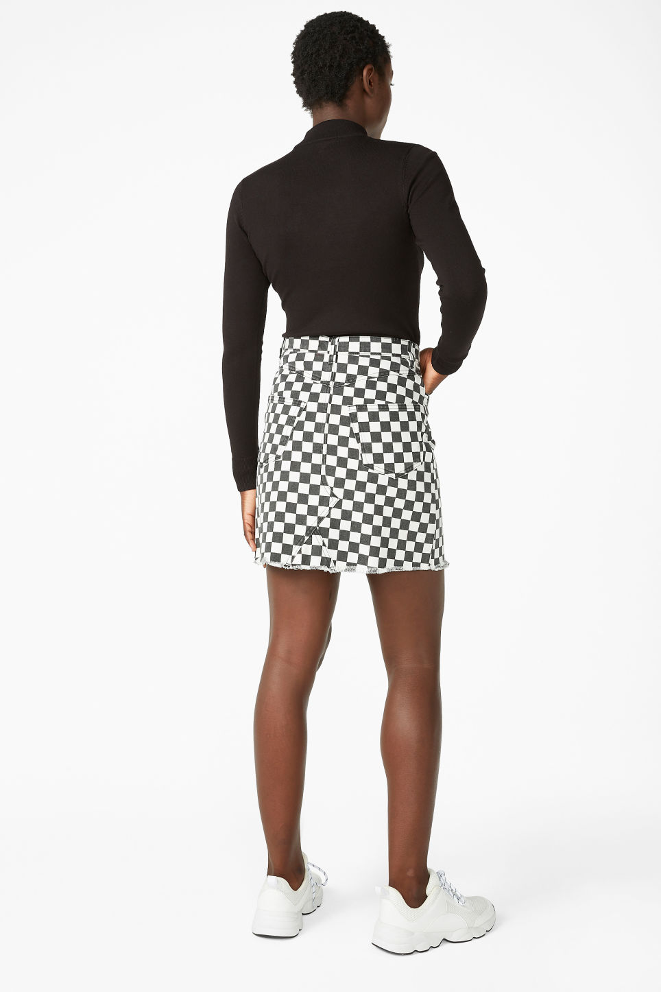 Model back image of Monki denim mini skirt  in white