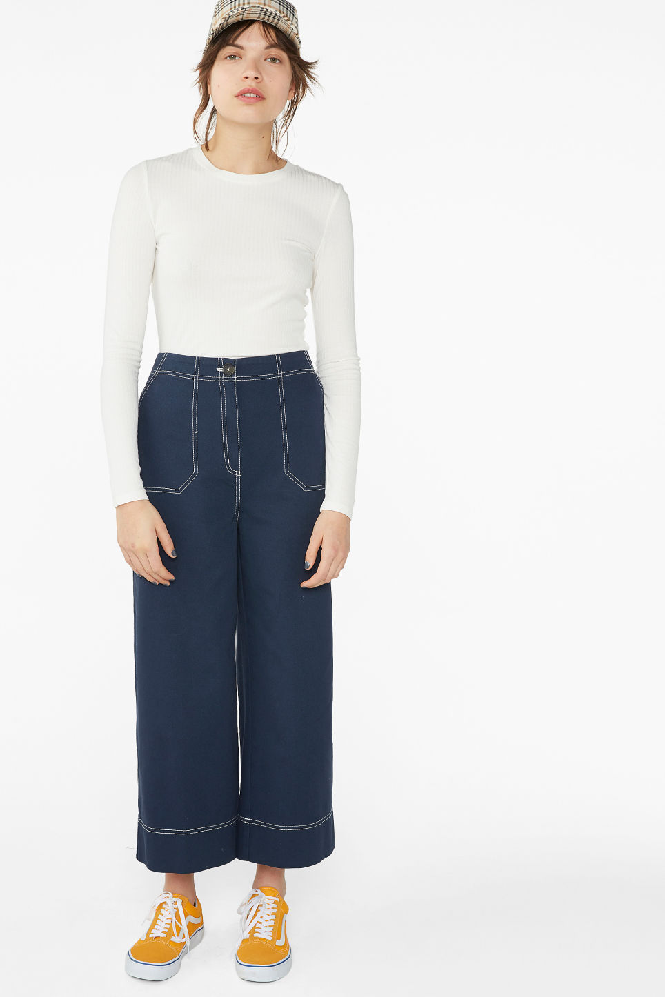 Model side image of Monki long-sleeved ribbed top in white