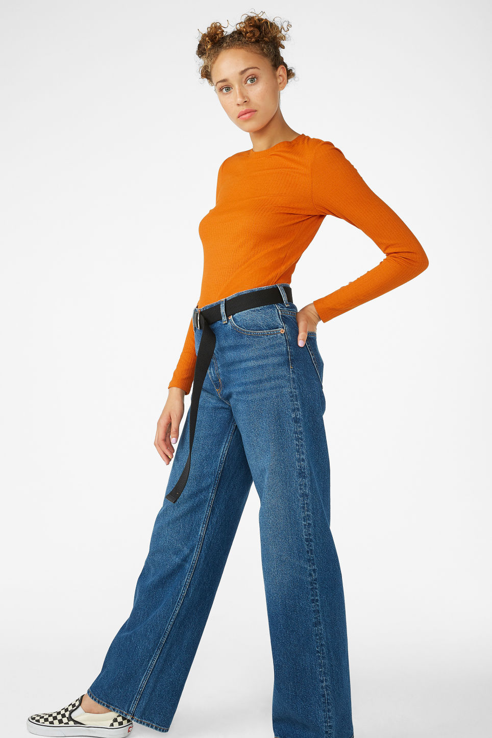 Model side image of Monki long-sleeved ribbed top in orange