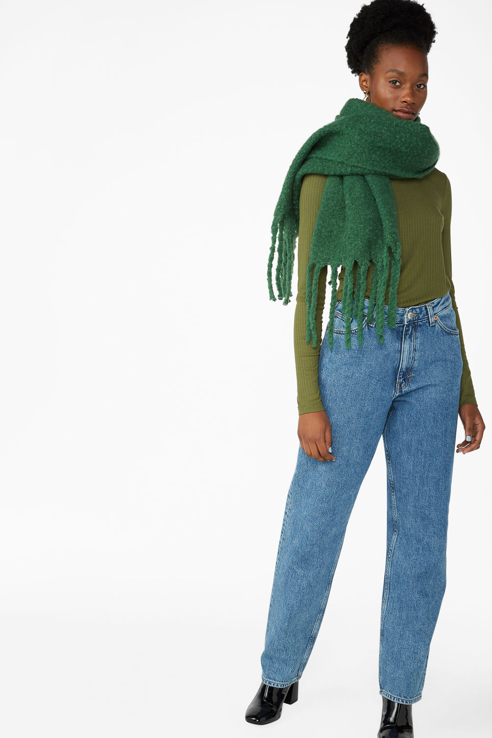 Model side image of Monki long-sleeved ribbed top in green