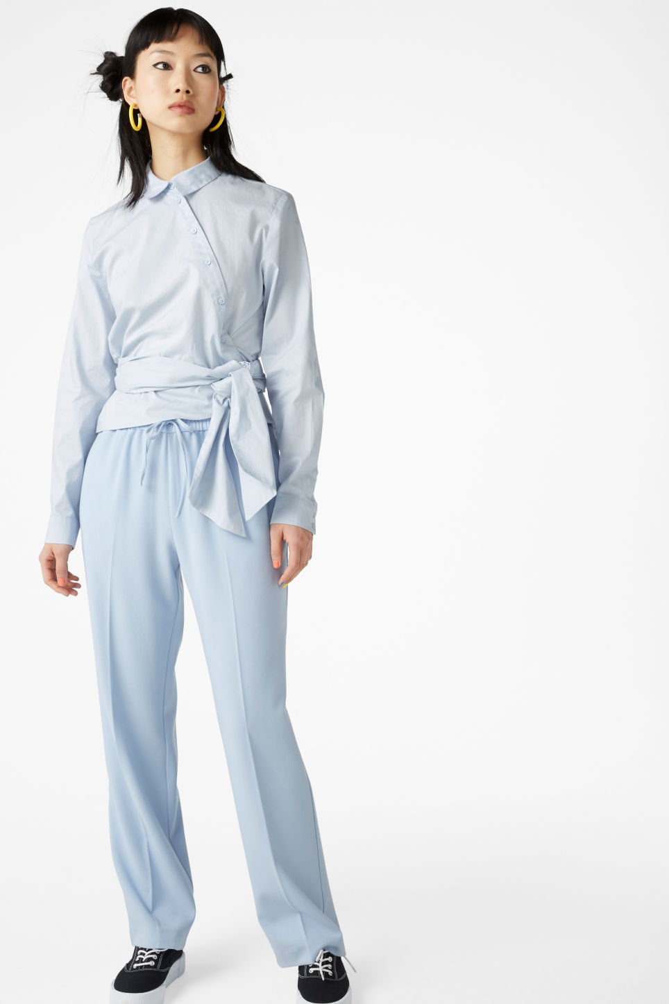 Model side image of Monki cotton blouse in blue