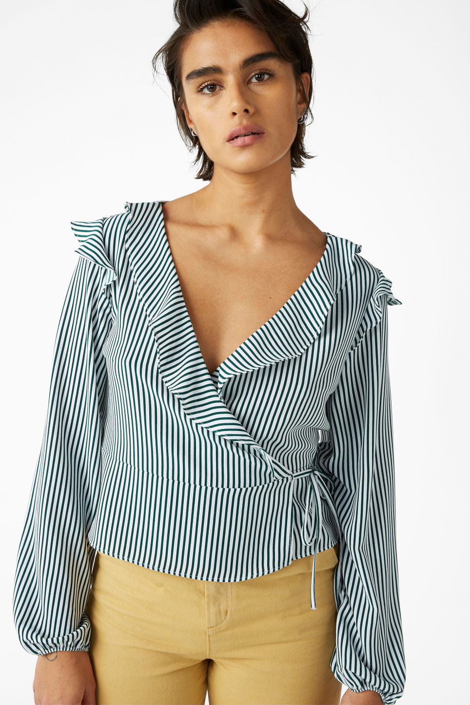 Model front image of Monki ruffle wrap blouse in green