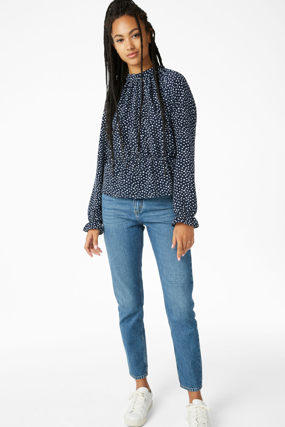 Model side image of Monki high-necked blouse in blue