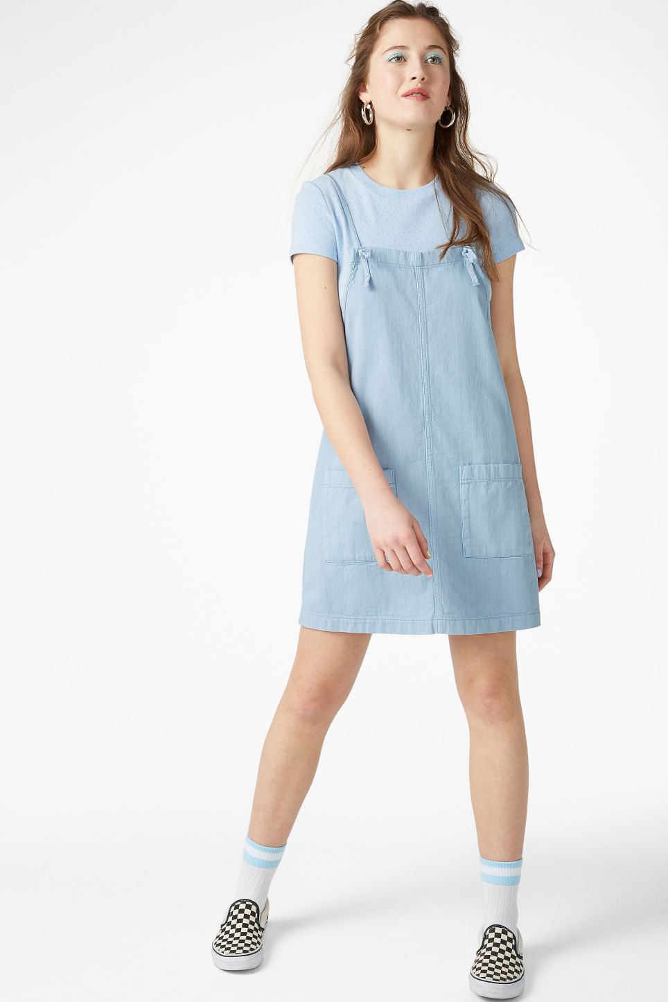 Model side image of Monki denim dress in blue