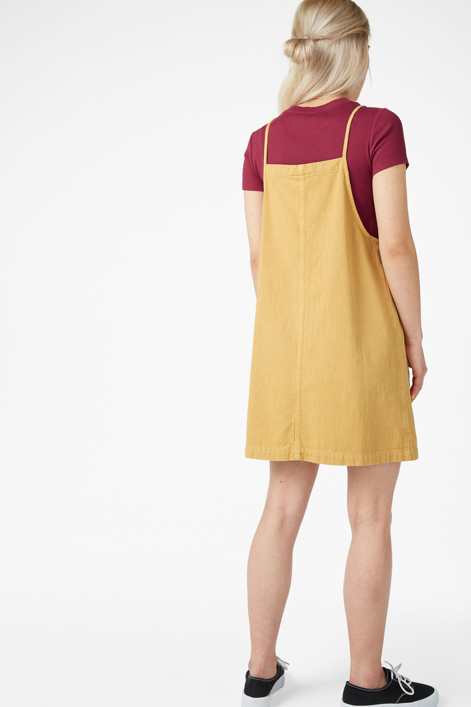 Model back image of Monki denim dress in yellow