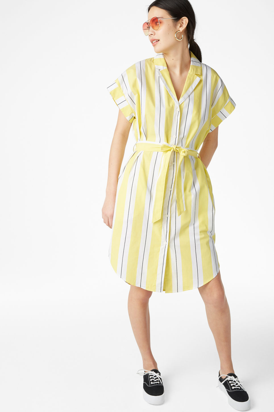Model side image of Monki short-sleeved shirt dress in yellow