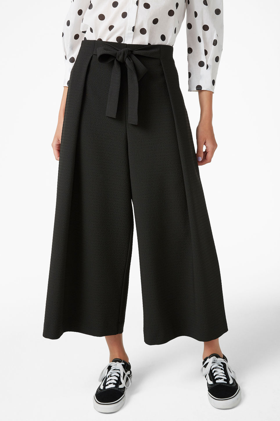 Model side image of Monki wide leg trousers in black