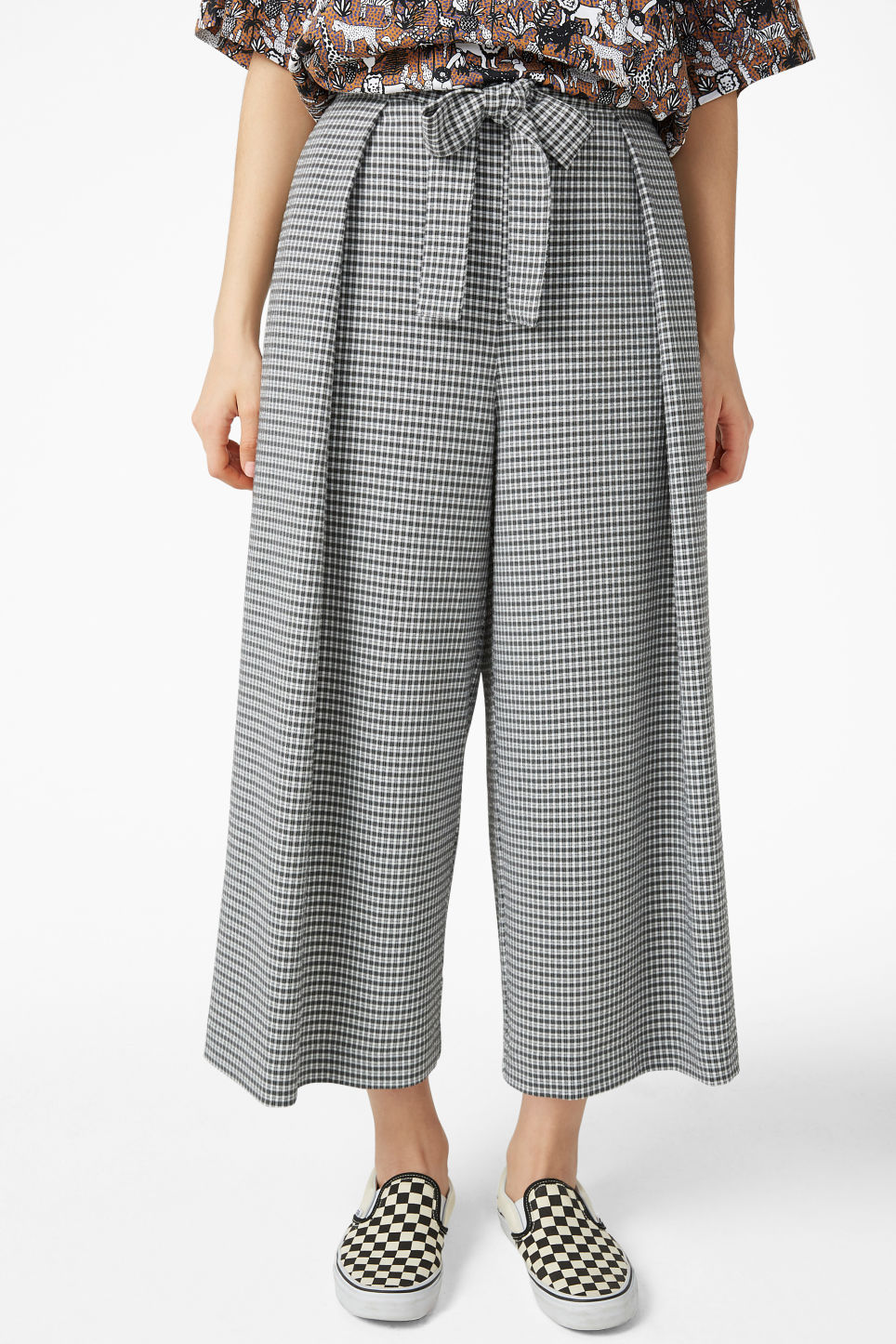 Model side image of Monki wide leg trousers in white