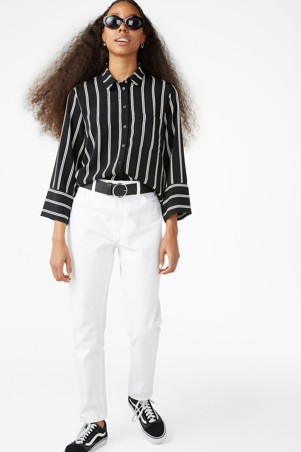 Model side image of Monki oversized button-up blouse in black