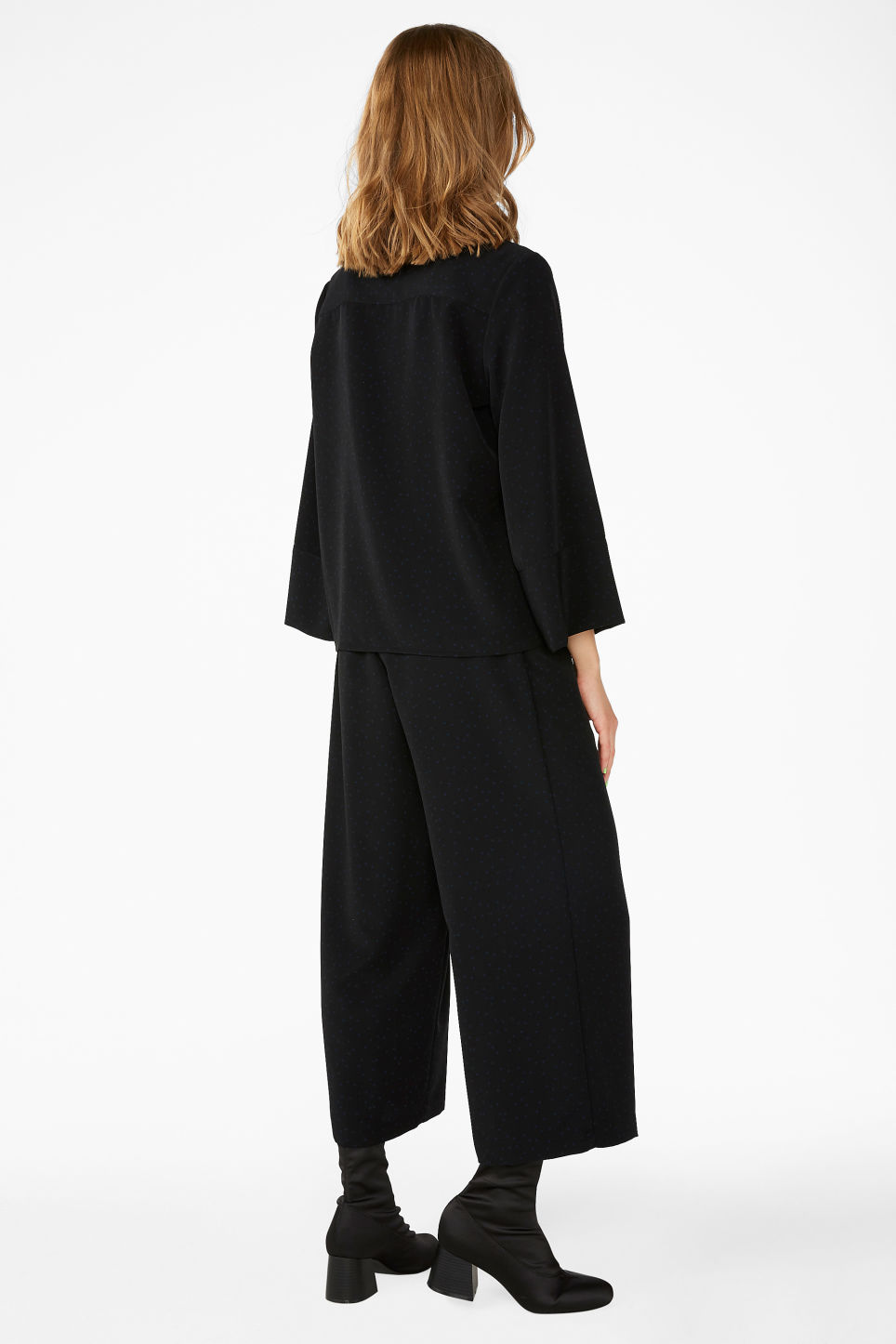 Model back image of Monki wide button-up blouse in black