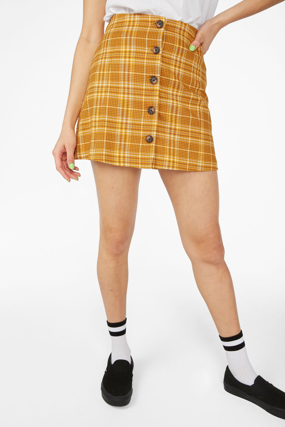 Model side image of Monki a-line mini skirt  in yellow