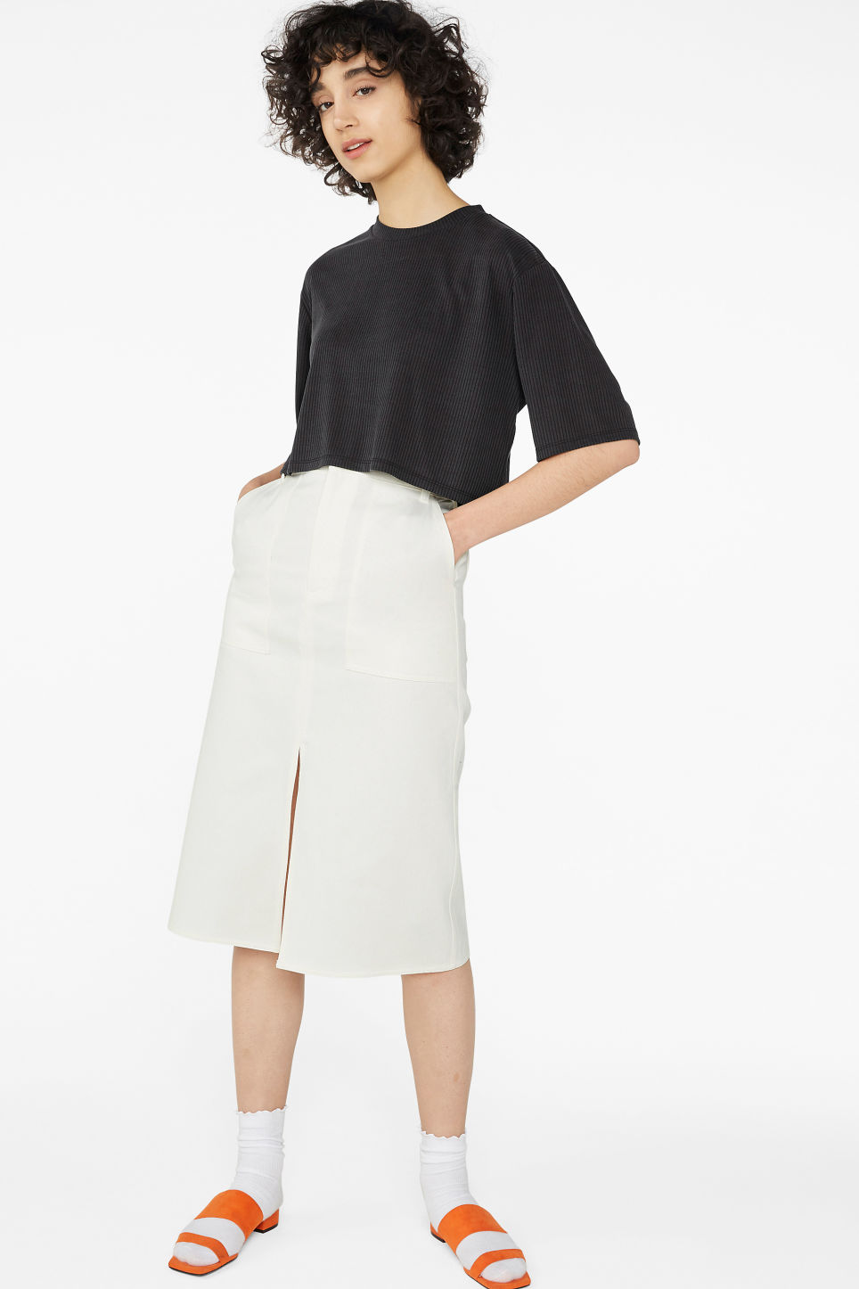 Model side image of Monki cropped top in black