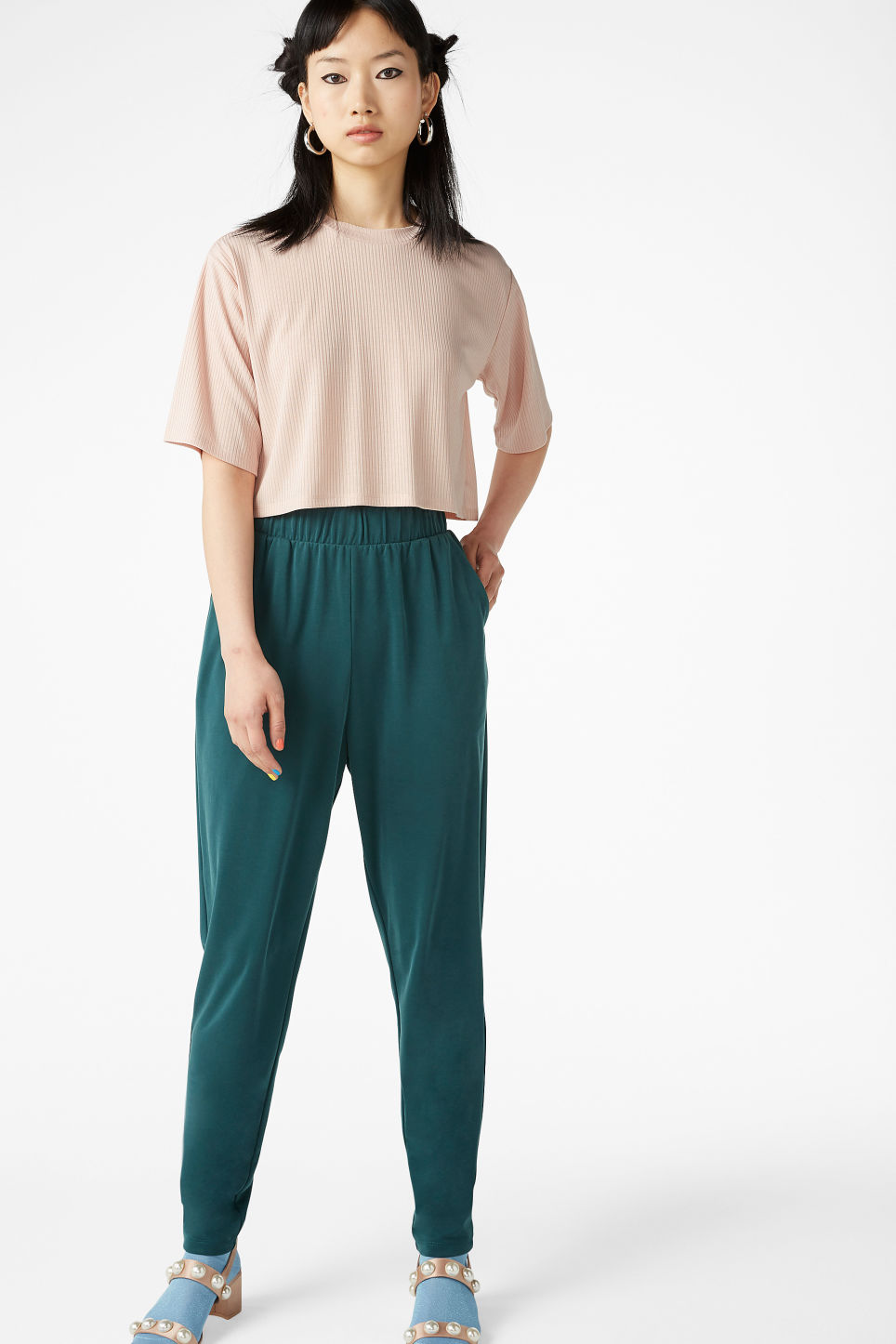 Model side image of Monki cropped top in orange