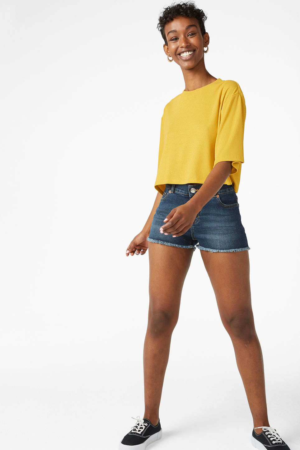 Model side image of Monki cropped top in yellow