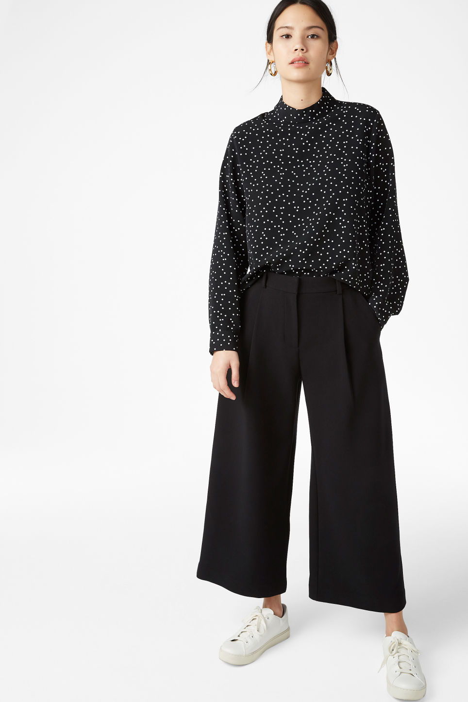 Model side image of Monki turtleneck blouse in black
