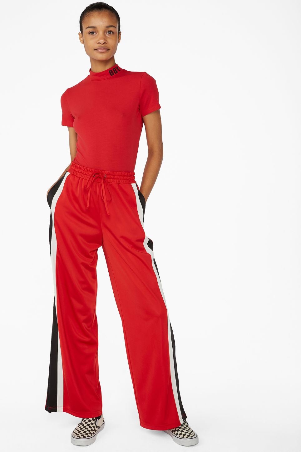 Model side image of Monki short-sleeved turtleneck in red