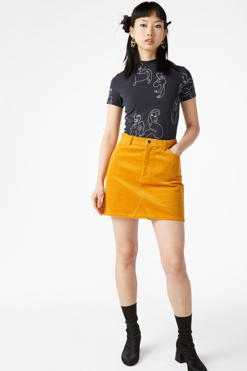 Model front image of Monki corduroy mini skirt in yellow